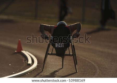 A wheelchair athlete racing during competition - stock photo