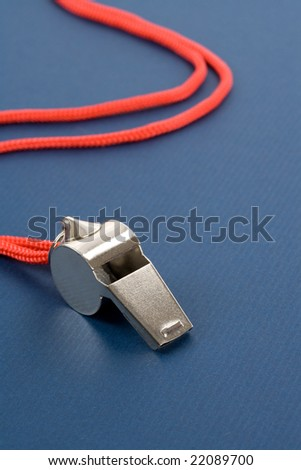 a whistle with blue background - stock photo