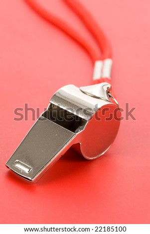 a whistle with red background - stock photo