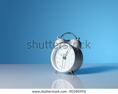 A white alarm clock shot on a gradient blue background - stock photo