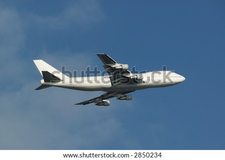 a white bodied boeing 747 just departed - stock photo