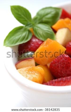 A white bowl of freshly chopped fruit salad - stock photo