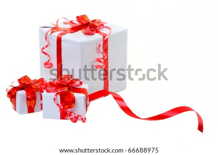 A white box tied with a red satin ribbon bow. A gift for Christmas, Birthday, Wedding, or Valentine's day.