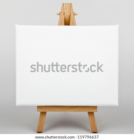 A white canvas on an easel.