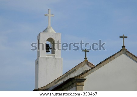 A white Catholic Church with 3 Crosses - stock photo