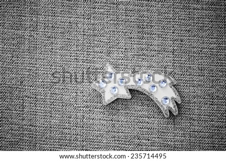 a white christmas star on a grey background - stock photo
