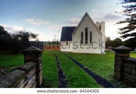 A white church at sunset - stock photo