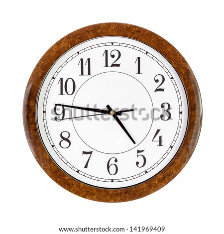 A white clock face showing forty six minutes past five - stock photo