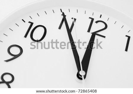 a white clock - five minutes to twelve - stock photo