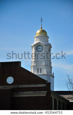 A white clocktower rising above buildings in West Hartford, Connecticut.