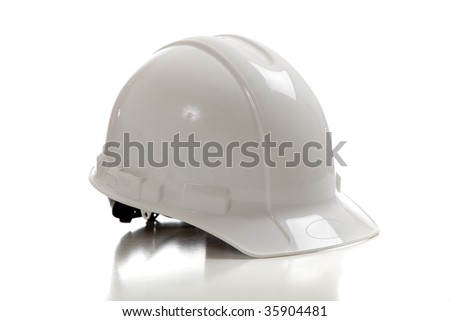 A white construction workers hard hat on a white background - stock photo