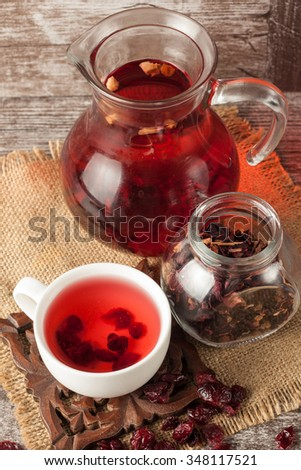 A white cup of green, red natural tea with ginger, lemon and honey on wooden rustic background. Healthy drink. Hot winter beverage concept.
