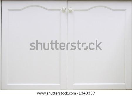 A white cupboard door. - stock photo