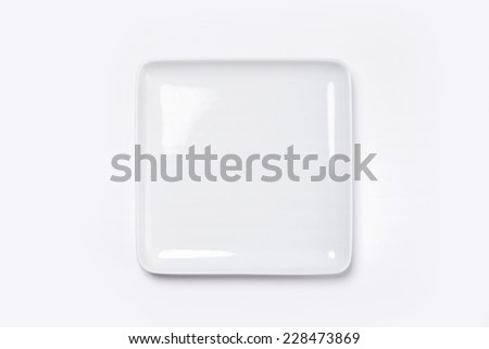 A white dish(plate) isolated white(grey) and top view. - stock photo
