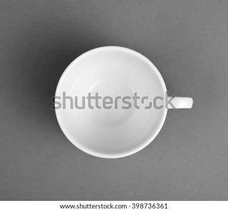 A white espresso cup on gray background