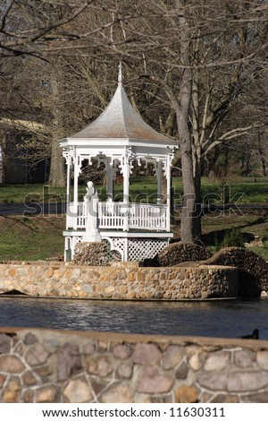 A white gazebo in the park. - stock photo