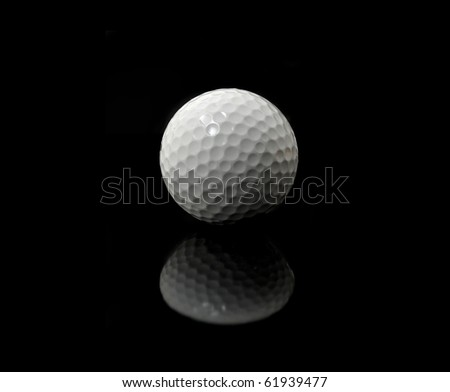 a white golf ball in front of a black background