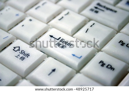 A white keyboard with multiple-language. - stock photo