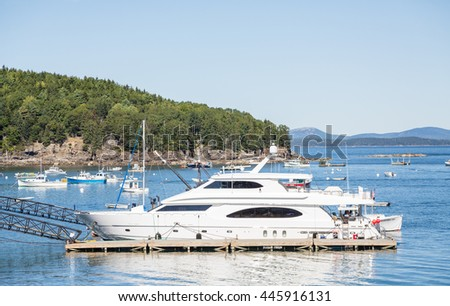 A white luxury yacht docked in Bar Harbor, Maine - stock photo
