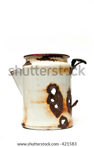 a white, metal coffee pot - apparently used by someone as target practice. - stock photo