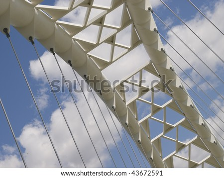 A white metal suspension bridge along the lakeshore in Toronto, Ontario, Canada. - stock photo
