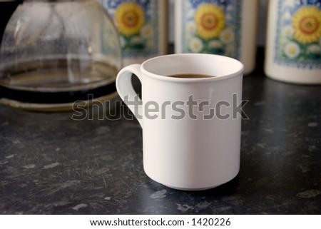 A white mug of coffee - stock photo