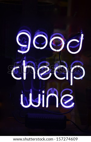 A white neon sign reading Good Cheap Wine - stock photo