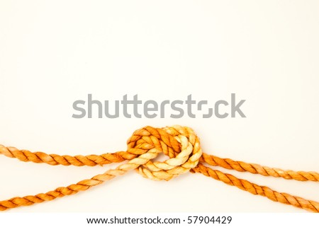 A white note with a knot of rope. - stock photo