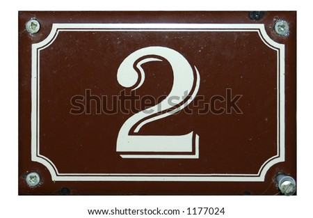 A white number 2 on a brown background plate, held in place by four screws - stock photo