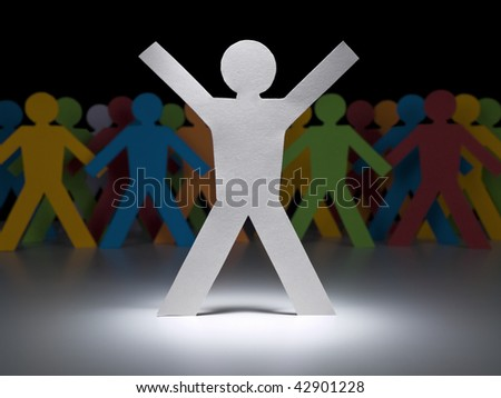 A white paper figure stands under the spotlight in front of multicolor crew.