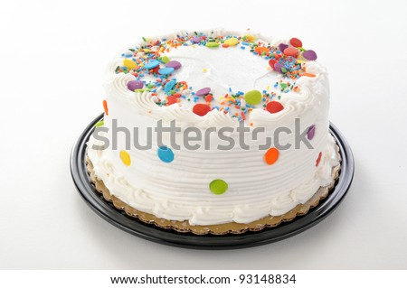A white party cake on a white table cloth - stock photo