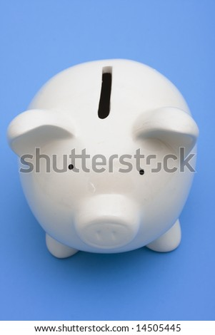A white piggy bank on a blue background