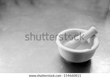 A white porcelain mortar on white background - stock photo