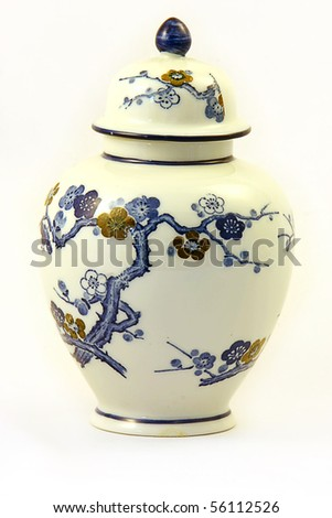A white porcelain oriental pot with a tree in blossom design - stock photo