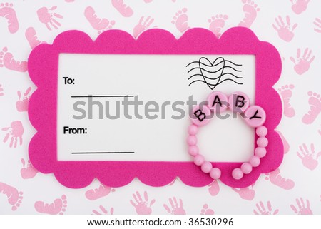 A white postcard with a pink border and baby bracelet on a hand and footprint background, baby shower invitation
