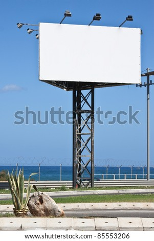 A White Poster advertising in blue sky - stock photo