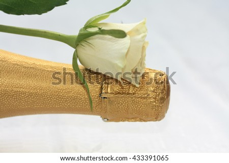A white rose on a champagne bottle