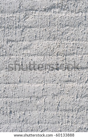 A white roughly textured brick wall painted with white paint - stock photo