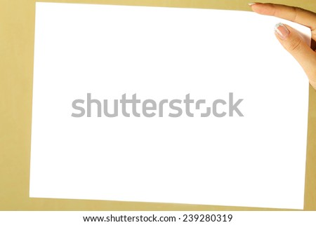 a white sheet of paper in a female hand - stock photo