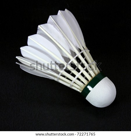 a white shuttlecock isolated on black - stock photo