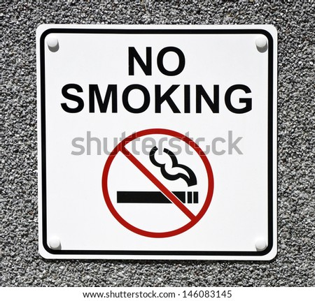 A white sign that reads No Smoking in black letters - stock photo