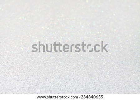 A white snow shining on a sunny winter day. Colorful and festive. - stock photo