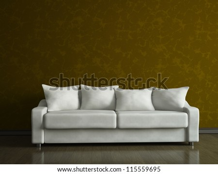 A white sofa near the brown wall - stock photo