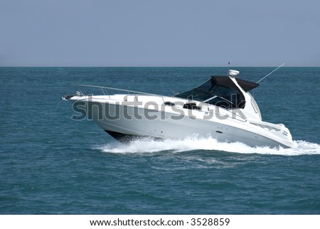 A white speedboat at the height of summer. - stock photo