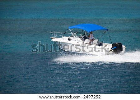 A white speedboat in the Caribbean. - stock photo