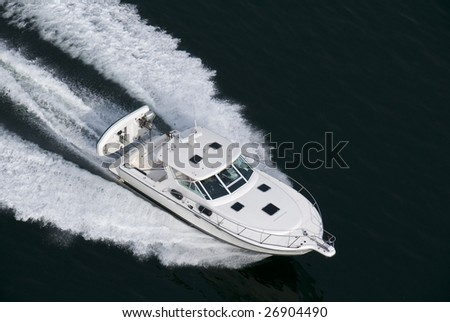 A white speedboat shot from above while traveling fast. - stock photo