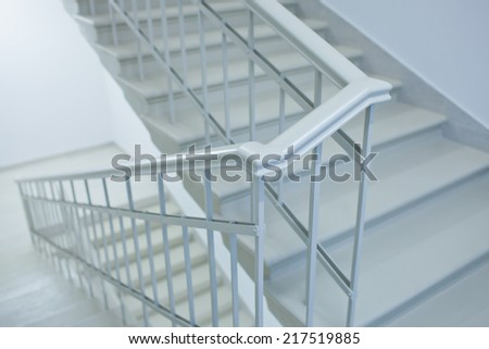 A white stairs up ladder in a new office building - stock photo