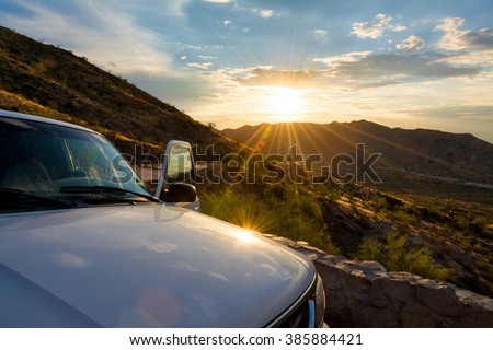 A white SUV parked with door open at a scenic overlook in South Mountain Park.  Phoenix, Arizona. - stock photo