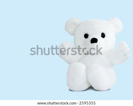 A white teddy bear, isolated on blue - stock photo