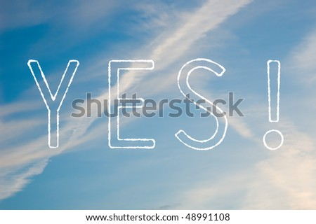 A white text saying Yes! against a blue sky. - stock photo